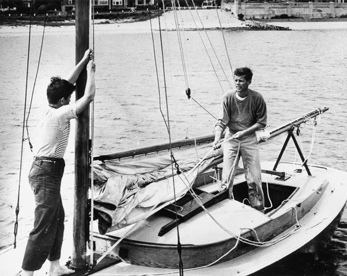 """PC 184A circa 1946 John F. Kennedy and brother Edward M. Kennedy aboard """"Victura"""", Hyannis Port, Massachusetts. Photograph in the John F. Kennedy Presidential Library and Museum, Boston."""