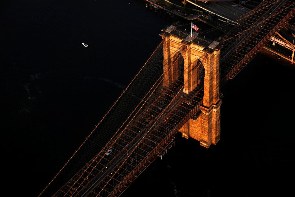 The rising sun lights the Brooklyn Bridge in New York